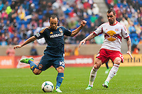 Landon Donovan (10) of the Los Angeles Galaxy is marked by Jonny Steele (22) of the New York Red Bulls. The New York Red Bulls defeated the Los Angeles Galaxy 1-0 during a Major League Soccer (MLS) match at Red Bull Arena in Harrison, NJ, on May 19, 2013.