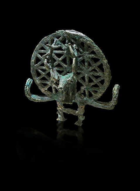 "Bronze Age Hattian ceremonial standard known as ""Sun Disks"" from possible Royal Bronze Age grave (2500 BC - 2200 BC)- Alacahoyuk - Museum of Anatolian Civilisations, Ankara, Turkey. Against a black background"