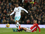 Diafra Sakho of West Ham United tackled by Marcos Rojo of Manchester United during the Premier League match at the Old Trafford Stadium, Manchester. Picture date: November 27th, 2016. Pic Simon Bellis/Sportimage