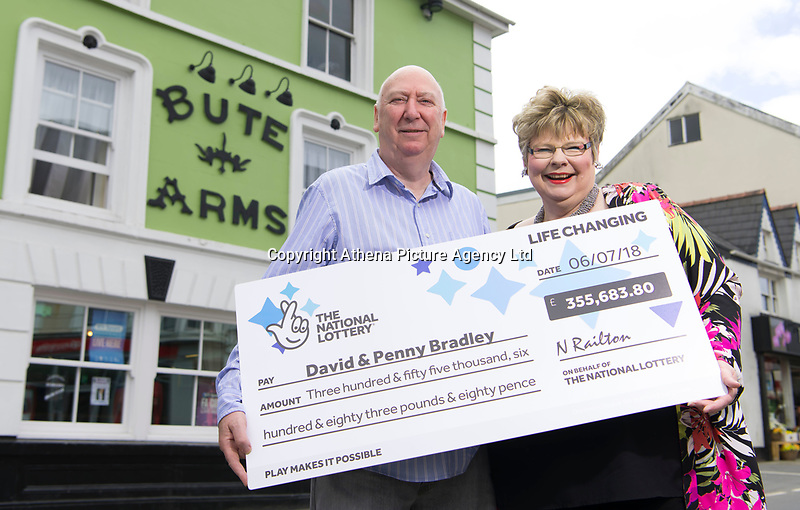 """COPY BY TOM BEDFORD<br /> Pictured: David and Penny Bradley at their pub in Aberdare, Wales, UK. Tuesday 24 July 2018<br /> Re: """"That's the last time I send him to do the lottery."""" David and Penny Bradley who missed out on £50m by one number - but still picked up £350,000.<br /> Pictured at their pub in Aberdare, South Wales"""