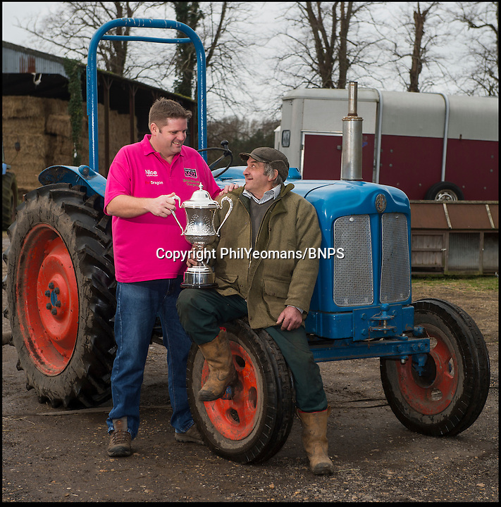 BNPS.co.uk (01202 558833)<br /> Pic: PhilYeomans/BNPS<br /> <br /> Scott with dad Jeff(67).<br /> <br /> New BDO Darts world champion Scott Mitchell(44) is back on the family farm in Bransgore, Hampshire, today - after promising to buy his father Jeff a new tractor with his winnings.