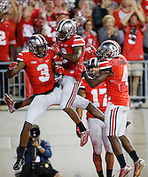 Ohio State Buckeyes wide receiver Michael Thomas (3), Ohio State Buckeyes running back Dontre Wilson (2), Ohio State Buckeyes running back Jalin Marshall (17) and Ohio State Buckeyes running back Curtis Samuel (4) celebrate Thomas' touchdown during the college football game between the Ohio State Buckeyes and the Virginia Tech Hokies at Ohio Stadium in Columbus, Saturday afternoon, September 6, 2014. The Virginia Tech Hokies defeated the Ohio State Buckeyes 35 - 21. (The Columbus Dispatch / Eamon Queeney)