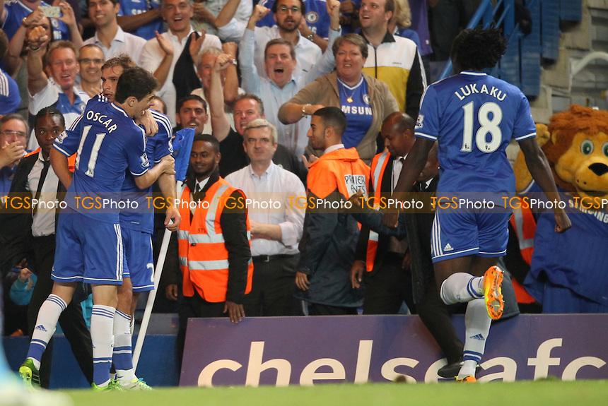 Oscar of Chelsea congratulates Branislav Ivanovic of Chelsea on his winner - Chelsea vs Aston Villa - Barclays Premier League Football at Stamford Bridge, Fulham Road, London - 21/08/13 - MANDATORY CREDIT: Simon Roe/TGSPHOTO - Self billing applies where appropriate - 0845 094 6026 - contact@tgsphoto.co.uk - NO UNPAID USE