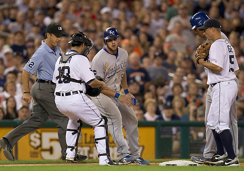 August 30, 2011:  Detroit Tigers catcher Alex Avila (#13) tags out Kansas City Royals third baseman Mike Moustakas (#8) as he heads back to an occupied third base during MLB game action between the Kansas City Royals and the Detroit Tigers at Comerica Park in Detroit, Michigan.  The Tigers defeated the Royals 2-1.