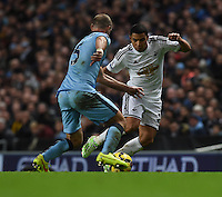 Picture by Howard Roe/AHPIX.com. Football, Barclays Premier League; <br /> Manchester City v Swansea City ;22/11/2014 KO 3.00 pm <br /> Etihad Stadium;<br /> copyright picture;Howard Roe;07973 739229<br /> Swansea's      Jefferson Montero runs at   Manchester's Zabaleta