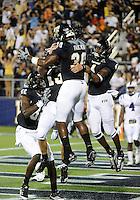 Florida International University football player tight end Jonathan Faucher (30) celebrates against the Duke University on October 01, 2011 at Miami, Florida. Duke won the game 31-27. .