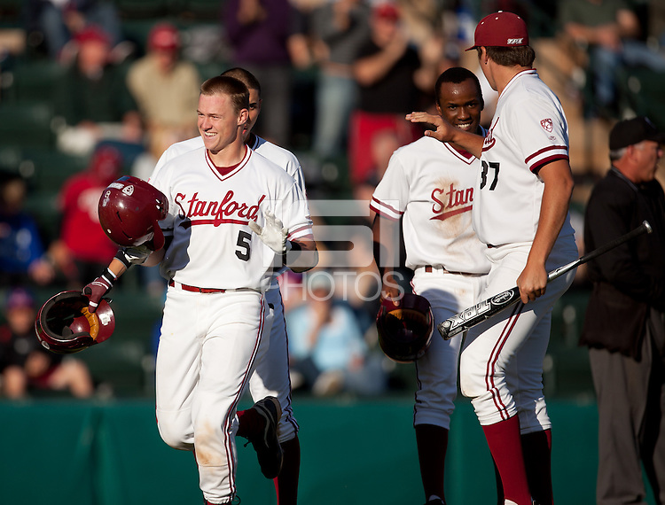 STANFORD, CA - April 21, 2011: Zach Jones of Stanford baseball is congratulated after driving in Lonnie Kauppila and Brian Ragira on a three run home run during Stanford's game against UCLA at Sunken Diamond. Stanford won 7-4.
