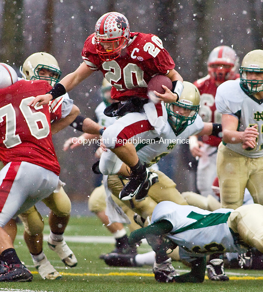 SHELTON, CT - 05 DECEMBER 2009 -120509JT10--<br /> Pomperaug's Benjamin Crick jumps over Notre Dame's Daniel Pfau during Saturday's Class L state high football title. The Panthers lost, 21-28.<br /> Josalee Thrift Republican-American