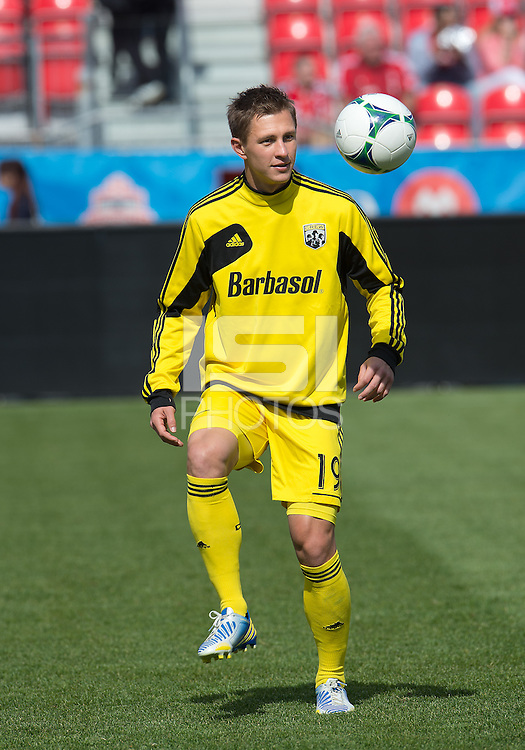18 May 2013: Columbus Crew midfielder Konrad Warzycha #19 warm-ups during an MLS game between the Columbus Crew and Toronto FC at BMO Field in Toronto, Ontario Canada..The Columbus Crew won 1-0...