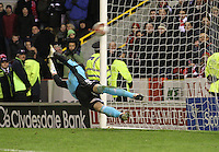 Marc McAisland's penalty flies past Jamie Langfield in the Aberdeen v St Mirren Scottish Communities League Cup match played at Pittodrie Stadium, Aberdeen on 30.10.12..