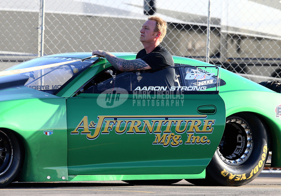 Feb 12, 2016; Pomona, CA, USA; NHRA pro stock driver Aaron Strong during qualifying for the Winternationals at Auto Club Raceway at Pomona. Mandatory Credit: Mark J. Rebilas-USA TODAY Sports