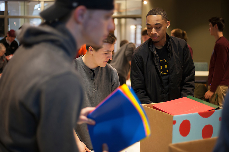 Student volunteers sort and pack donated school supplies in Baker Center on Saturday, Jan 28, 2017. The supplies will be sent to elementary schools in Trimble, Alexander, Coolville, and The Plains.