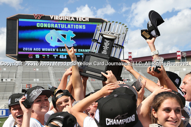 01 May 2016: UNC players celebrate with the championship trophy. The University of North Carolina Tar Heels played the Syracuse University Orange at Lane Stadium in Blacksburg, Virginia in the 2016 Atlantic Coast Conference Women's Lacrosse Tournament championship match. North Carolina won 15-14 in overtime.