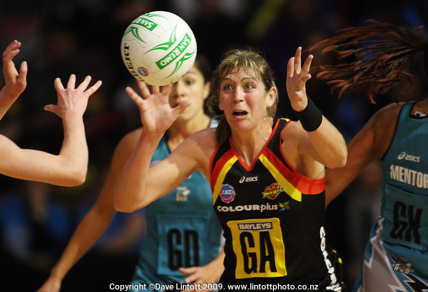 Magic goal attack Irene Van Dyk takes a pass during the ANZ Netball Championship match between the Waikato Bay of Plenty Magic and Adelaide Thunderbirds, Mystery Creek Events Centre, Hamilton, New Zealand on Sunday 19 July 2009. Photo: Dave Lintott / lintottphoto.co.nz