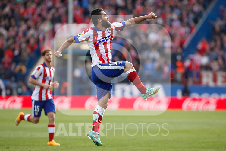 Atletico de Madrid´s Arda Turan celebrates a goal during 2014-15 La Liga match between Atletico de Madrid and Deportivo de la Coruña at Vicente Calderon stadium in Madrid, Spain. November 30, 2014. (ALTERPHOTOS/Victor Blanco)
