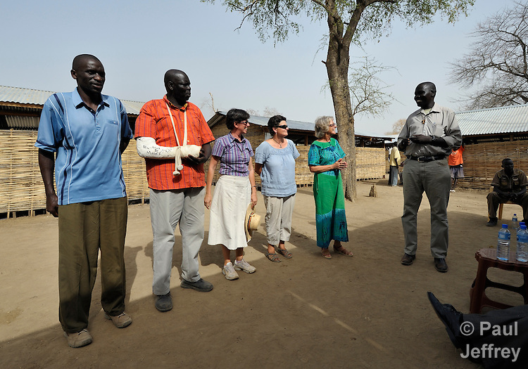 Father Biong Kuol (right) thanks members and volunteers of Solidarity with South Sudan during a ceremony closing a special teacher training course in Agok, a town in Abyei along the contested border between Sudan and South Sudan where more than 100,000 Dinka Ngok fled in 2011 after attacks by northern soldiers and militias on their villages in Abyei. The Catholic parish of Abyei, with support from Caritas South Sudan and other international church partners, has maintained its pastoral presence among the displaced and assisted them with food, shelter, and other relief supplies. Solidarity with South Sudan, an international network of Catholic groups, assists the world's newest country with training of teachers, health care professionals and pastoral workers at several locations.