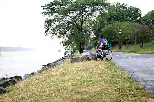 Minda takes a moment to mentally prepare herself prior to competing in the Aquaphor New York City Triathlon in New York on July 8, 2012.