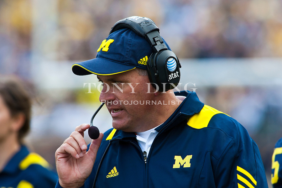 Michigan head coach Rich Rodriguez, speaks into his headset, paces the sidelines in the fourth quarter of an NCAA college football game with Connecticut, Saturday, Sept. 4, 2010, in Ann Arbor. Michigan won 30-10. (AP Photo/Tony Ding)