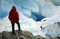 Hiker at Cataract Glacier, Harriman Fiord, Prince William Sound, Chugach National Forest, Alaska.