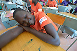 A student rests on her desk at the Loreto Girls Secondary School in Rumbek, South Sudan. The school is run by the Institute for the Blessed Virgin Mary--the Loreto Sisters--of Ireland.