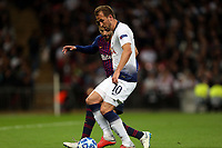 Harry Kane of Tottenham Hotspur and Gerard Pique of FC Barcelona during Tottenham Hotspur vs FC Barcelona, UEFA Champions League Football at Wembley Stadium on 3rd October 2018