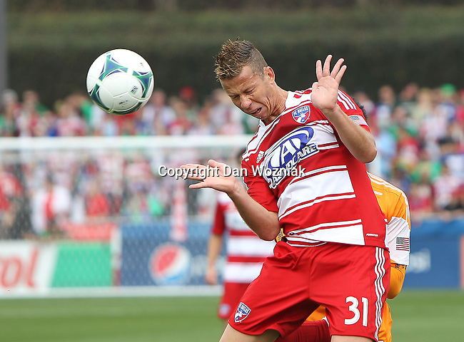 FC Dallas midfielder Michel (31) in action during the game between the FC Dallas and the Houston Dynamo at the FC Dallas Stadium in Frisco,Texas.