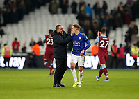 28th December 2019; London Stadium, London, England; English Premier League Football, West Ham United versus Leicester City; Leicester City Manager Brendan Rogers celebrates after the final whistle with Marc Albrighton of Leicester City on the pitch - Strictly Editorial Use Only. No use with unauthorized audio, video, data, fixture lists, club/league logos or 'live' services. Online in-match use limited to 120 images, no video emulation. No use in betting, games or single club/league/player publications