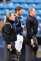 Umpire Jennifer Pawol, Asheville Tourists catcher Willie MacIver (23) and home plate umpire Sean Cassidy during the National Anthem before game one of a double header between the West Virginia Power and the Asheville Tourists at McCormick Field on April 20, 2019 in Asheville, North Carolina. The Tourists defeated the Power 12-7. (Tony Farlow/Four Seam Images)