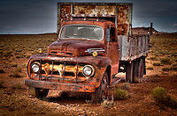 Rusting old trucks parked in the desert near the Petrified Forest National Park, Holbrook Arizona.
