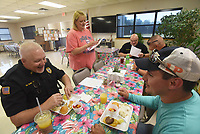 NWA Democrat-Gazette/FLIP PUTTHOFF <br /> THANK YOU GRAVETTE FIRST RESPONDERS<br /> Melissa Steele, direcor of the Billy V. Hall Gravette Senior and Wellness Center, talks Wednesday June 6 2019 with Gravette police officers during an appreciation breakfast for the city's first responders, including police and firefighters. Officer Mike Savage (from left), Chief Chuck Skaggs, Officer Josh Crane and Detective Braxton Handle dine Wednesday morning at the breakfast.