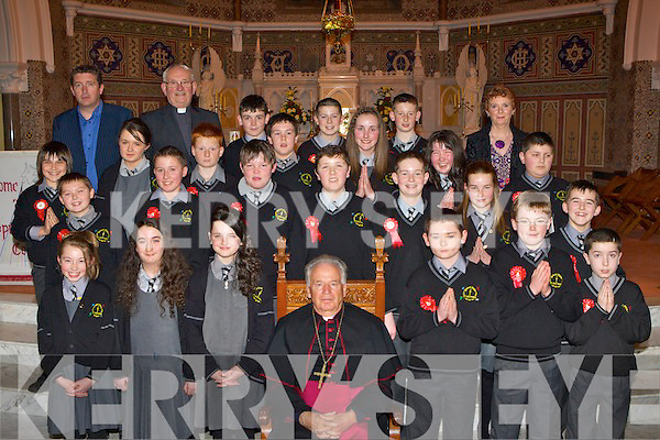 Bishop Bill Murphy with the pupils of Gaelscoil Aogain, Castleisland after their confirmation in St Stephen and John's church Castleisland on Thursday