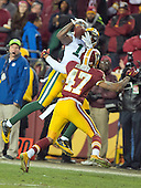 Green Bay Packers wide receiver Davante Adams (17) makes a catch over Washington Redskins cornerback Quinton Dunbar (47) in second quarter action during an NFC Wild Card game at FedEx Field in Landover, Maryland on Sunday, January 10, 2016.  The Packers won the game 35 - 18.<br /> Credit: Ron Sachs / CNP