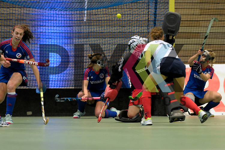GER - Luebeck, Germany, February 07: During the 1. Bundesliga Damen indoor hockey final match at the Final 4 between Mannheimer HC (blue) and Duesseldorfer HC (white) on February 7, 2016 at Hansehalle Luebeck in Luebeck, Germany.   Lisa-Marie Schuetze #19 of Duesseldorfer HC scores a penalty corner