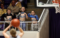 Woods Cross fans (left to right) Sam Bennion (8), Jacob Tribe (9), and Nathan Willes (8) show their spirit trying to distract a Payson player shooting a free throw. Ogden - Woods Cross vs. Payson High School boys basketball, 4A State Basketball Championships at the Dee Events Center Wednesday.