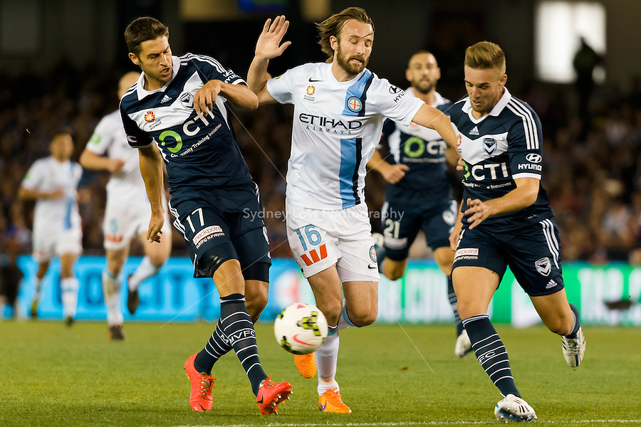 Mathieu Delpierre of the Victory and Joshua Kennedy of City fight for the ball in the semi final match between Melbourne Victory and Melbourne City in the Australian Hyundai A-League 2015 season at Etihad Stadium, Melbourne, Australia.<br />