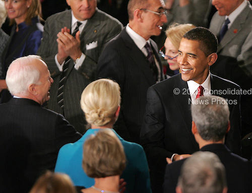 Washington, DC - January 20, 2009 -- United States President Barack Obama shares a laugh with United States Senator John McCain (Republican of Arizona), left, at the start of a luncheon at Statuary Hall in the U.S. Capitol  in Washington, Tuesday, January 20, 2009..Credit: Lawrence Jackson - Pool via CNP