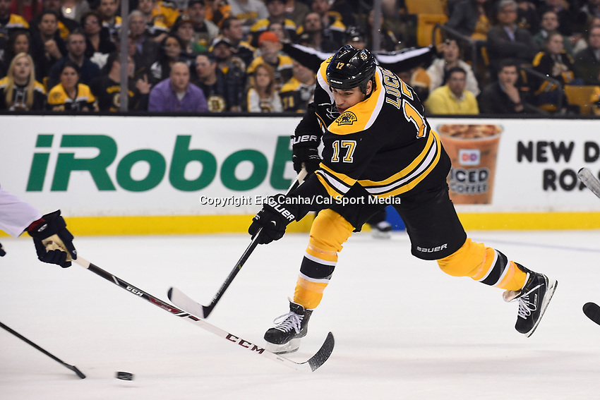 March 31, 2015 - Boston, Massachusetts, U.S. -  Boston Bruins left wing Milan Lucic (17) fires the game winning shot at the NHL match between the Florida Panthers and the Boston Bruins held at TD Garden in Boston Massachusetts. The Bruins defeated the Panthers 3-2 in regulation time. Eric Canha/CSM