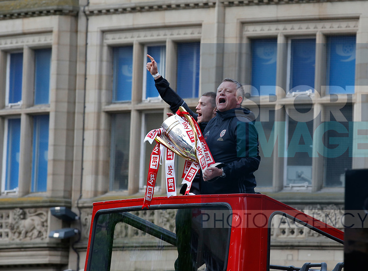 Chris Wilder manager of Sheffield Utd and Paul Count during the open top bus parade from Bramall Lane Stadium to Sheffield Town Hall, Sheffield. Picture date: May 2nd 2017. Pic credit should read: Simon Bellis/Sportimage