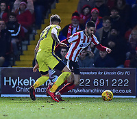 Lincoln City's Sam Habergham vies for possession with Cheltenham Town's Joe Rodon<br /> <br /> Photographer Andrew Vaughan/CameraSport<br /> <br /> The EFL Sky Bet League Two - Lincoln City v Cheltenham Town - Tuesday 13th February 2018 - Sincil Bank - Lincoln<br /> <br /> World Copyright &copy; 2018 CameraSport. All rights reserved. 43 Linden Ave. Countesthorpe. Leicester. England. LE8 5PG - Tel: +44 (0) 116 277 4147 - admin@camerasport.com - www.camerasport.com
