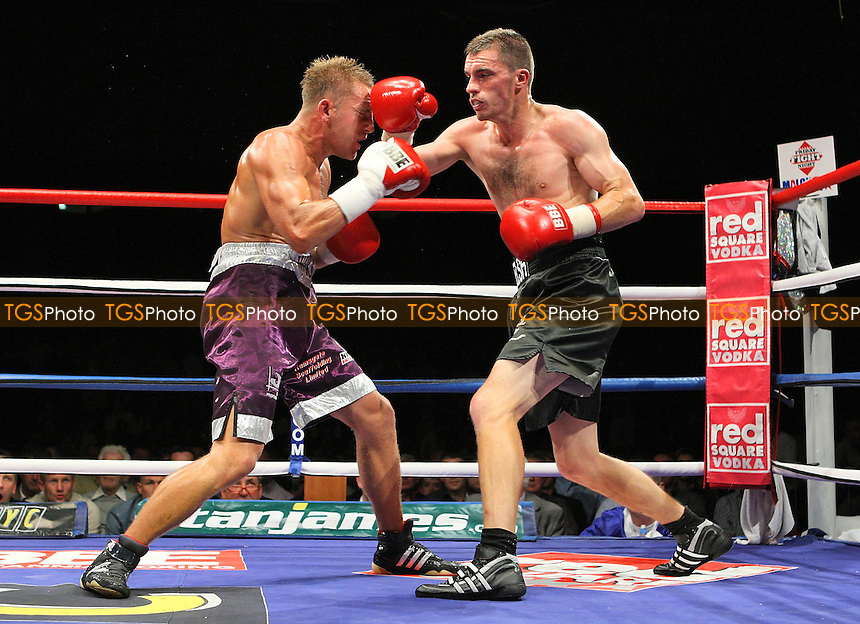 Martin Welsh (black shorts) defeats Vinny Woolford in a Welterweight Boxing contest at the Brentwood International Centre, promoted by Maloney Promotions - 11/09/09 - MANDATORY CREDIT: Gavin Ellis/TGSPHOTO - Self billing applies where appropriate - Tel: 0845 094 6026