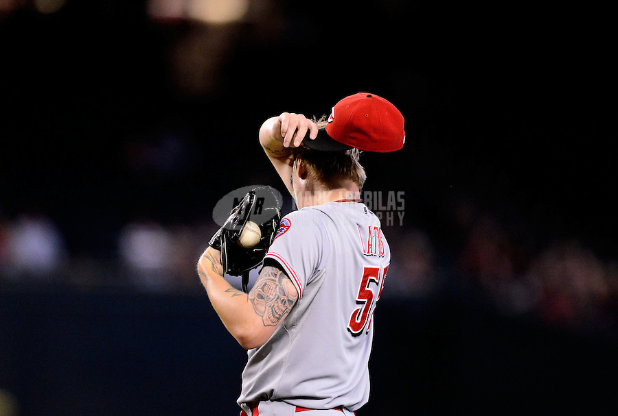 Aug. 29, 2012; Phoenix, AZ, USA: Cincinnati Reds pitcher Mat Latos reacts in the first inning against the Arizona Diamondbacks at Chase Field. Mandatory Credit: Mark J. Rebilas-