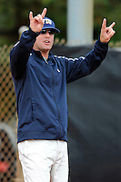 11 February 2012:  FIU Head Coach Jake Schumann signals to runners from the third-base position as the University of Louisville Cardinals defeated the FIU Golden Panthers, 4-2, as part of the COMBAT Classic at the FIU Softball Complex in Miami, Florida.