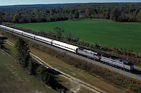 Aerial view of an Amtrack passenger train on the railroad's mainline to Washington, DC just north of Richmond. Mass Transportation,. Virginia, Central Virginia.