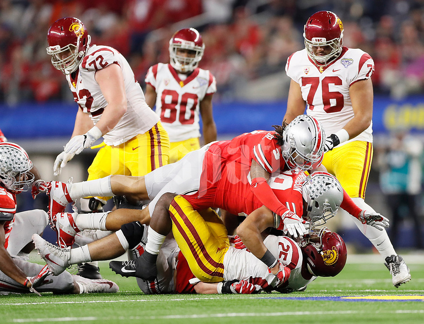 Ohio State Buckeyes defensive lineman Tyquan Lewis (59) and cornerback Damon Arnette (3) tackle USC Trojans running back Ronald Jones II (25) in the fourth quarter of the 24-7 win over the USC Trojans in the Goodyear Cotton Bowl Classic at AT&T Stadium in Arlington, Texas on Dec. 29, 2017. [Adam Cairns / Dispatch]