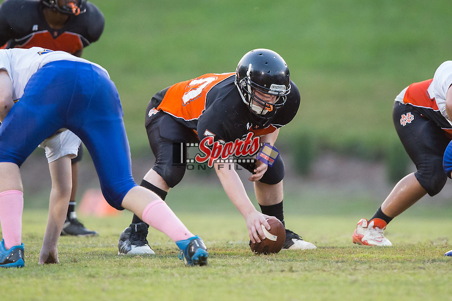 Isaac Haywood (70) of the Northwest Cabarrus Trojans during first half action against the Mount Pleasant Tigers in JV football action at Trojan Stadium on October 2, 2014, in Concord, North Carolina.  The Tigers defeated the Trojans 42-6.  (Brian Westerholt/Sports On Film)