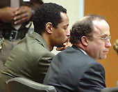 Convicted sniper John Allen Muhammad, left, gets emotional as letters from his children are read in court during the penalty phase of his trial in courtroom 10 at the Virginia Beach Circuit Court in Virginia Beach, Virginia on November 20, 2003.   Defense attorney Peter Greenspun is at right. <br /> Credit: Lawrence Jackson - Pool via CNP