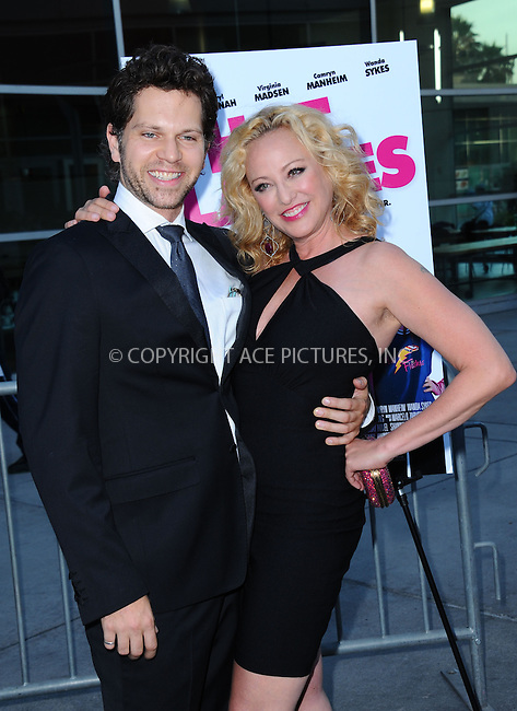 WWW.ACEPIXS.COM<br /> <br /> June 27 2013, LA<br /> <br /> Virginia Madsen and Nick Holmes arriving at the premiere of 'The Hot Flashes' at ArcLight Cinemas on June 27, 2013 in Hollywood, California.<br /> <br /> By Line: Peter West/ACE Pictures<br /> <br /> <br /> ACE Pictures, Inc.<br /> tel: 646 769 0430<br /> Email: info@acepixs.com<br /> www.acepixs.com