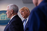 United States President Donald J. Trump listens as US Vice President Mike Pence makes remarks on the Coronavirus crisis in the Brady Press Briefing Room of the White House in Washington, DC on Saturday, March 21, 2020.<br /> Credit: Stefani Reynolds / Pool via CNP/AdMedia
