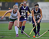 Carle Place No. 14 Elissa Frein, left, Oyster Bay No. 10 Robin Yeh look to gain possession during the Nassau County varsity field hockey Class C final at Adelphi University on Sunday, November 1, 2015. Frein tallied two goals and two assists in Carle Place's 5-0 win.<br /> <br /> James Escher