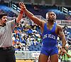 Tyreek Bromley of Long Beach, right, raises his arm after his victory by decision over Roman Aguirre of Oceanside at 182 pounds in the Nassau County Divsision I varsity wrestling quarterfinals at Hofstra University on Saturday, Feb. 11, 2017.